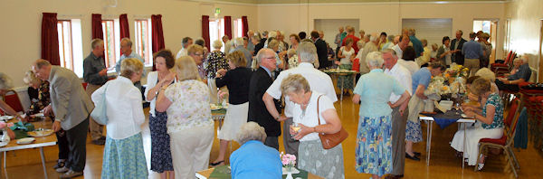 Volunteers in Pulborough Village Hall sharing refreshments, interests and enthusiasm